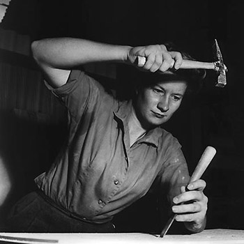 Beverly Willis working with a hammer and chisel.
