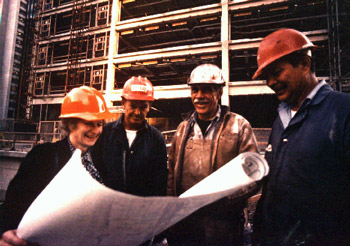 Beverly Willis on job site reviewing blueprints.