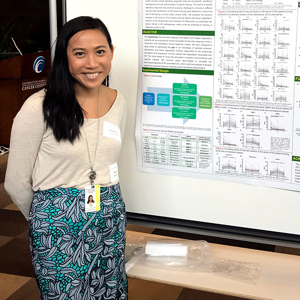 Lauren Ching in front of her research poster.