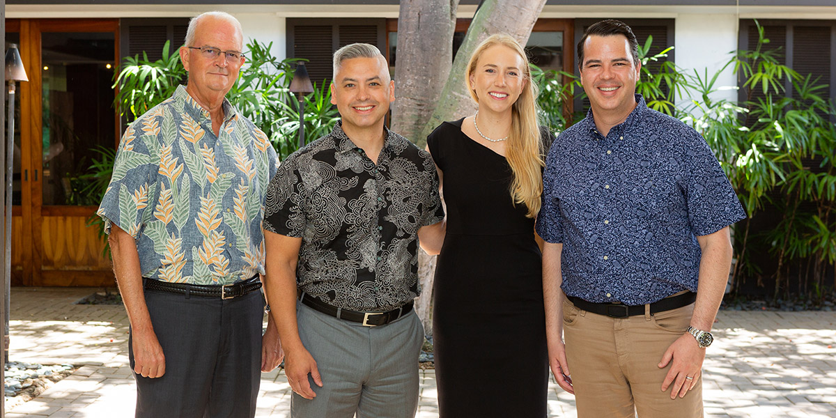 From left: Vance Roley, dean of the Shidler College of Business, with representatives from Northwestern Mutual Hawai'i, Jamie Delgadillo, managing director; Jessica Katinszky, director of career development; and Thomas Stewart, managing partner.
