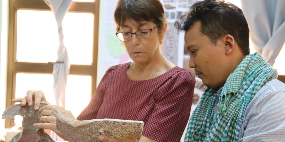 Miriam Stark (UH Manoa) and Tep Sokha (Ministry of Culture and Fine Arts, Cambodia) consult during Khmer Production and Exchange Ceramics Workshop at APSARA National Authority, June 2017