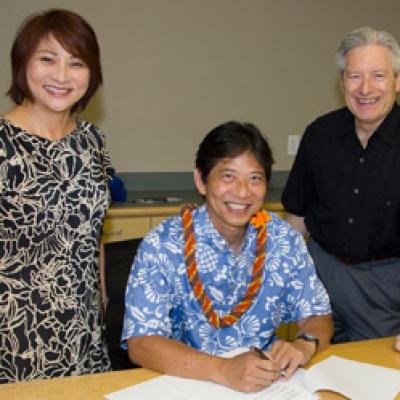 L-R:  Iris Takushi, JABSOM Scholarship Director; Ric Wo, Benedict and Miriam Lau Foundation Trustee; JABSOM Dean Jerris Hedges