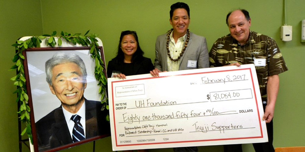 Hawai'i Community College Chancellor Rachel Solemsaas, Rep. Clift Tsuji's son Ryan Kalei Tsuji, and UH Hilo Vice Chancellor for Academic Affairs Matt Platz celebrate a generous donation of $81,054 from 159 donors contributing to newly established scholarship funds in memory of Rep. Clift Tsuji.