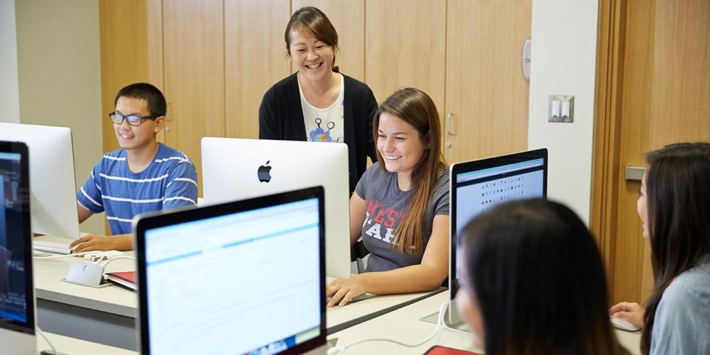 UHWO Associate Director, Creative Media Sharla Hanaoka working with students in the UH West Oʻahu Creative Media lab.