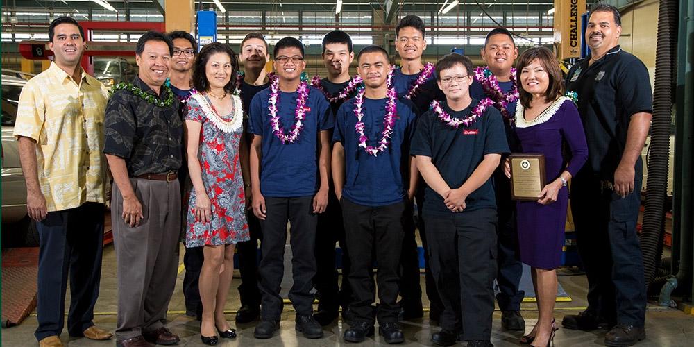 First Hawaiian Bank representatives Ben Akana, Joyce Borthwick, and Sharon Shiroma Brown congratulated students at the 2016 Summer Auto Academy graduation.