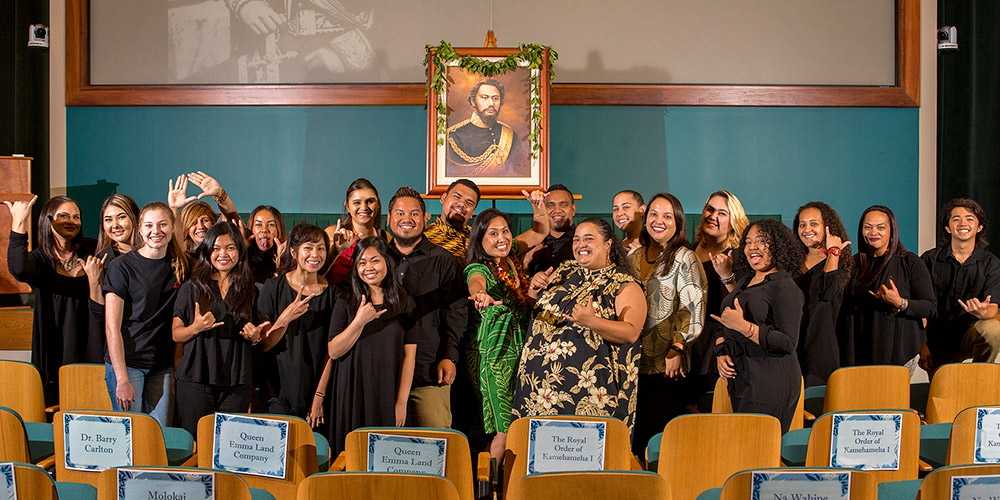 UH West O'ahu student scholarship recipients joined Dr. Diane Paloma (center, in green) at King Kamehameha IV's birthday celebration at The Queen's Medical Center.