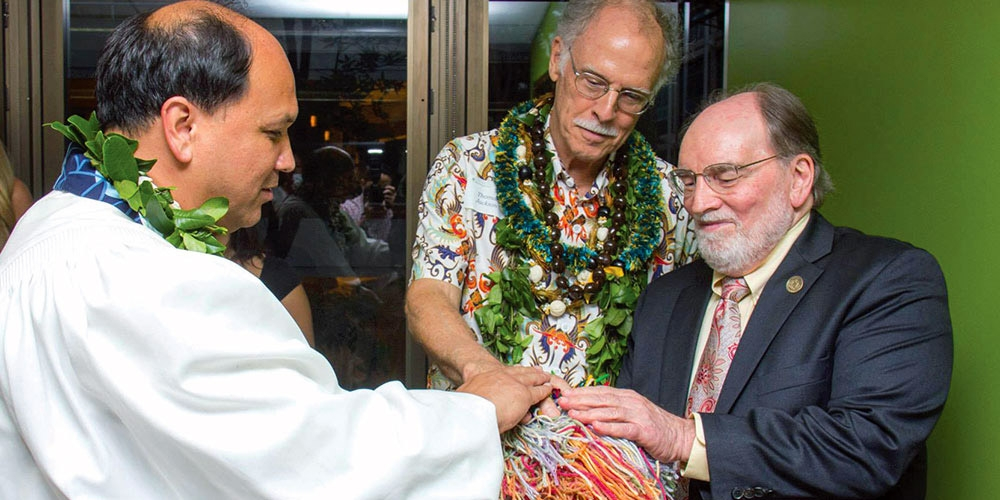 Kahu Cordell Kekoa blesses the community ball – a symbol of p4c Hawai'i – with Governor Neil Abercrombie and UH Uehiro Academy Director Dr. Thomas Jackson.